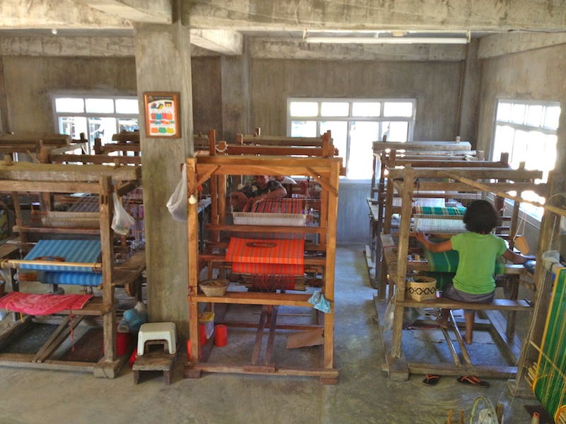 Through reinvestment, Aling Naty has been able to buy new looms and expand weaving from a part-time to a full-time activity for the village mothers. Her weaving center has looms over 100 years old and brand new. Local carpenters learned to repair and make them for her. The newest one is in the middle and was made for PHP 11,000 (approximately USD $250).
