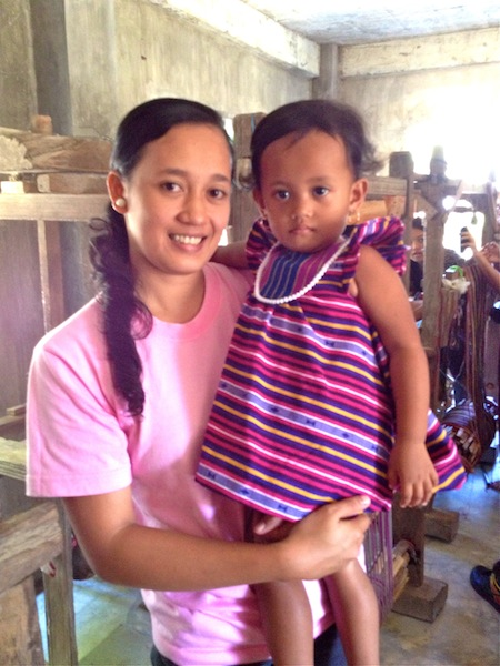 Ana is the 2nd youngest weaver in Abra. Her learning the craft is a testament to weaving's growth and potential. Her 2-year old daughter Natalie is wearing a Sugarcane dress.