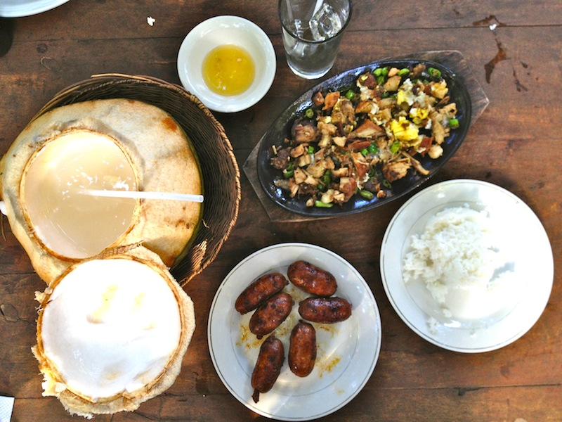 Ilocano lunch is not so healthy. Bagnet sisig, Vigan longanisa, and fresh coconut