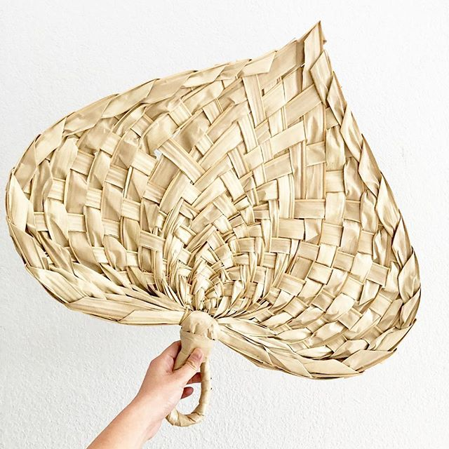 "I have only 2 of these oversized 24"" handwoven palm leaf fans. Available today at the @sugarcanesf booth at @undiscoveredsf 🌴"