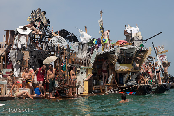 an older project but still one of the coolest one's I've seen - Swoon's swimming cities.  A bunch of rafts built from junk and floated down the river to the Venice Bienalle.    See more here: http://www.swimmingcities.org/photos/