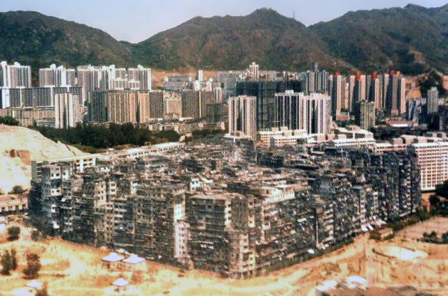 (from wikipedia)    Kowloon Walled City  was a  densely populated , largely ungoverned settlement in  Kowloon ,   Hong  Kong . Originally a  Chinese  military  fort , the Walled City became an  enclave  after the  New Territories  were leased to  Britain  in 1898. Its population increased dramatically  following the  Japanese occupation of Hong  Kong  during  World War II . From the 1950s to the 1970s, it  was controlled by  Triads  and  had high rates of  prostitution ,  gambling ,  and  drug use . In 1987, the Walled City  contained 33,000 residents within its 6.5-acre (0.03 km 2 ;  0.01 sq mi) borders.    more  here