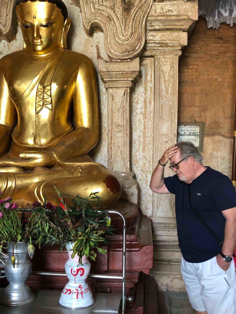Rubbing Buddha for good luck