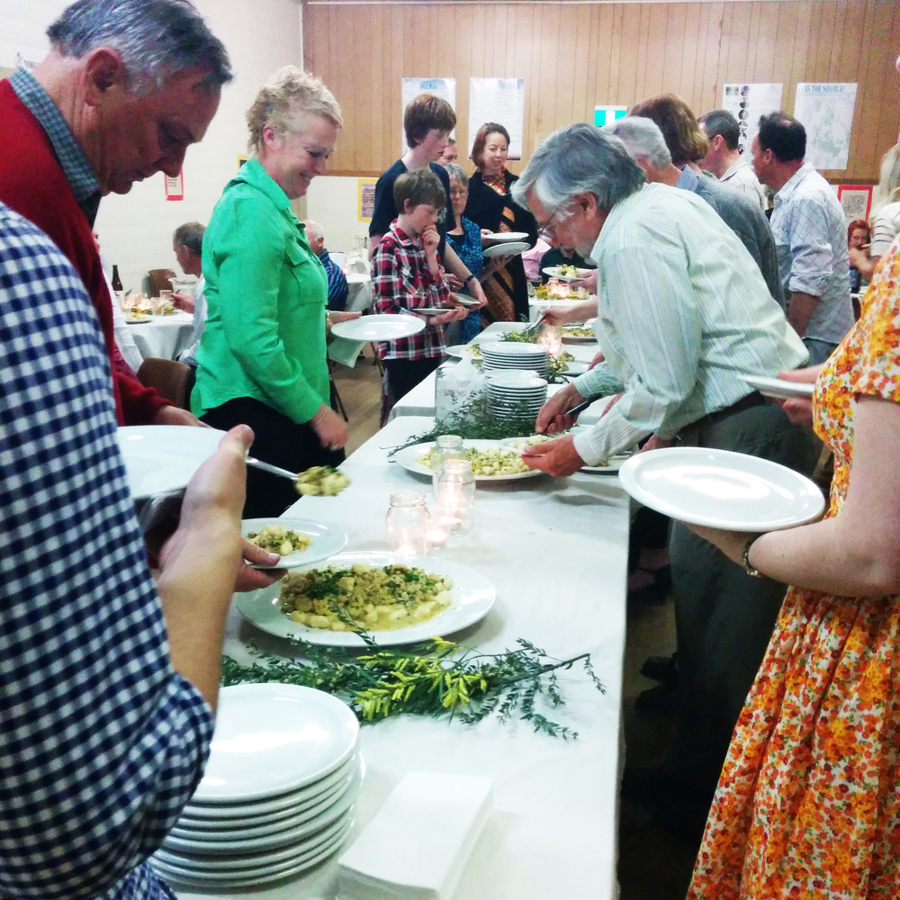 Guests plating up La Bonta's hand-made gnocchi with smoked trout and cannellini beans in a light saffron sauce at Trentham Food Hub's 2014 Growers, Cookers & Eaters Dinner