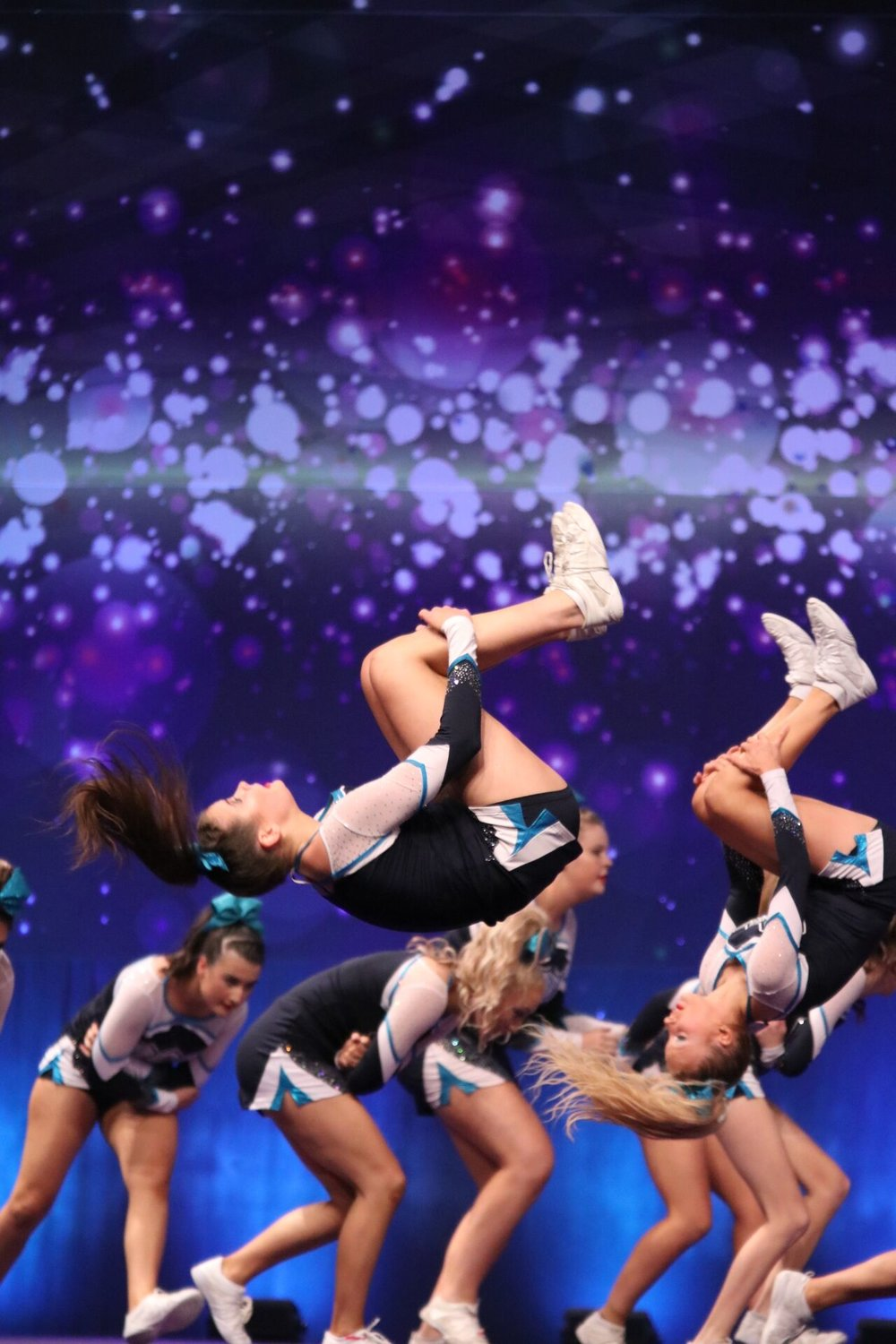 Tumble - Most people are more familiar with the tumbling side of cheer, as it is heavily based in gymnastics. Tumbling refers to the flips, rolls and cartwheels you would see in a cheerleading routine, similar to the floor skills in gymnastics.