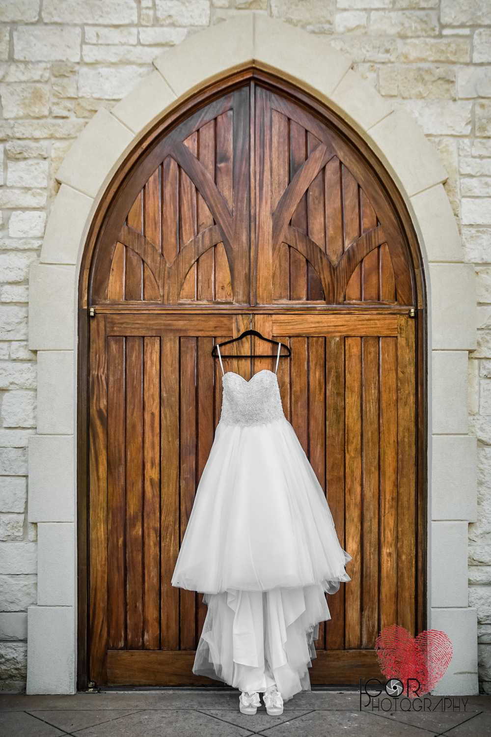 Wedding dress hanging at the chapel door