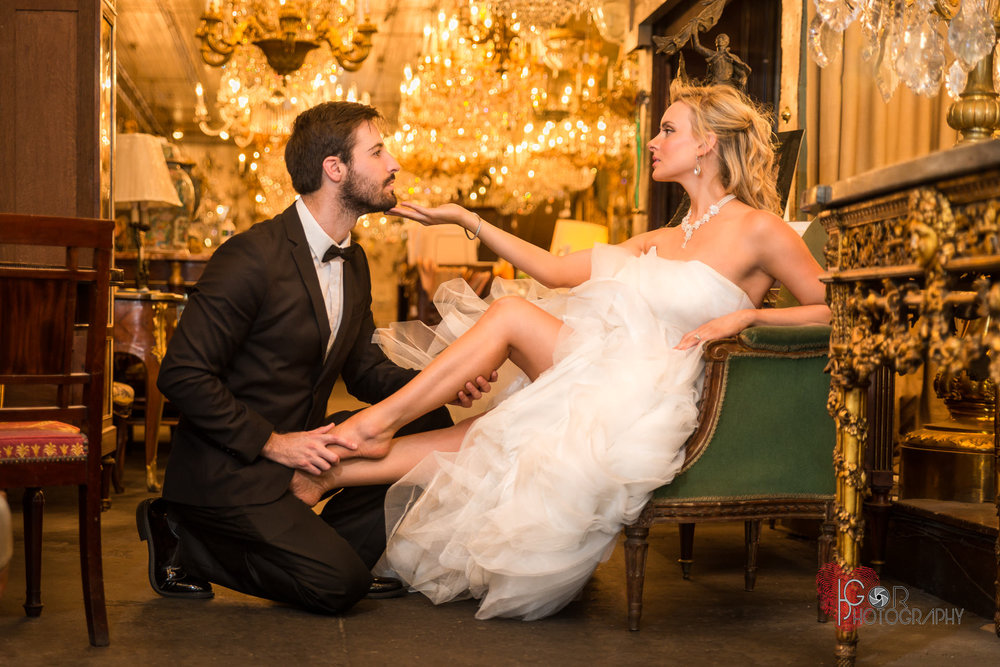 An elegant wedding photo in a stunning French Antique Shop at the French Quarter