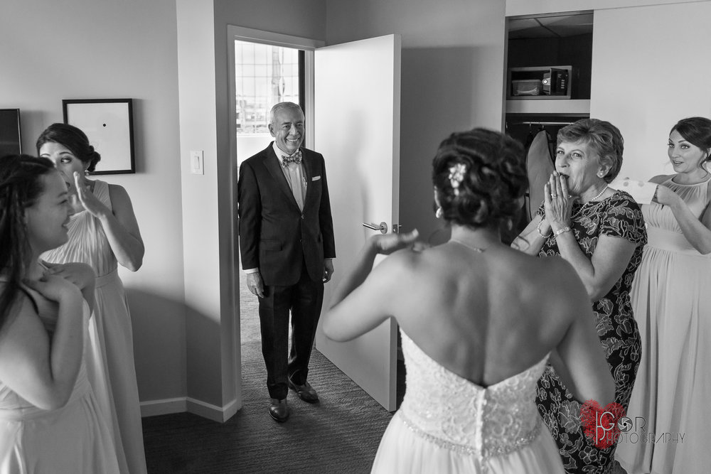Father viewing the bride for first time