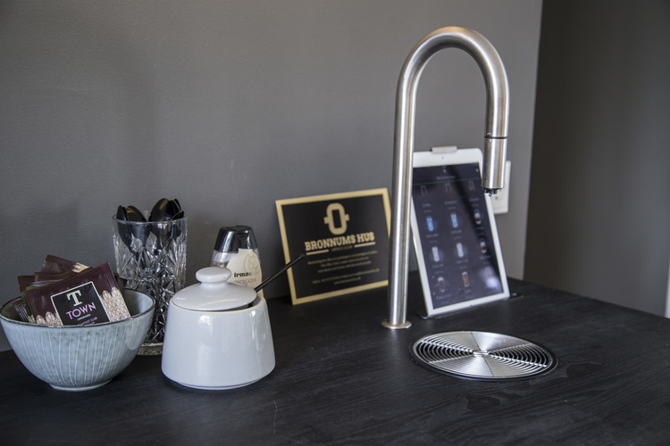 An uncommon coffee maker for an uncommon office space