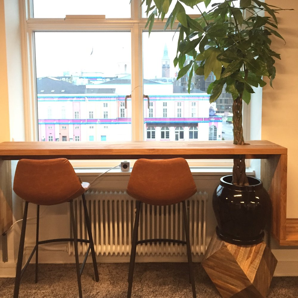Enjoying the view of Copenhagen - special made bench/high work spaces
