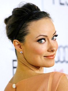 Gorgeous coral colours on Olivia Wilde