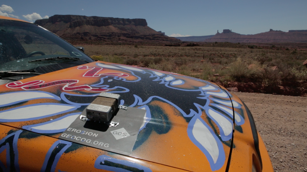 IMAGE # 14 TITLE: EROSION / ACCRETION (2015) LOCATION: Castle Valley, Utah DESCRIPTION: A sandstone hood ornament and collection boxes were attached to a taxi driving from New York to Los Angeles for a project called The Drive by Guillaume Le Vallois. The idea was to build analog sensors that looked at wind-based erosion and the accumulation of debris and sedimentation to see if distance could stand in as a measure of time in geomorphological terms. MATERIALS: sandstone, wax, brackets & bolts, paint