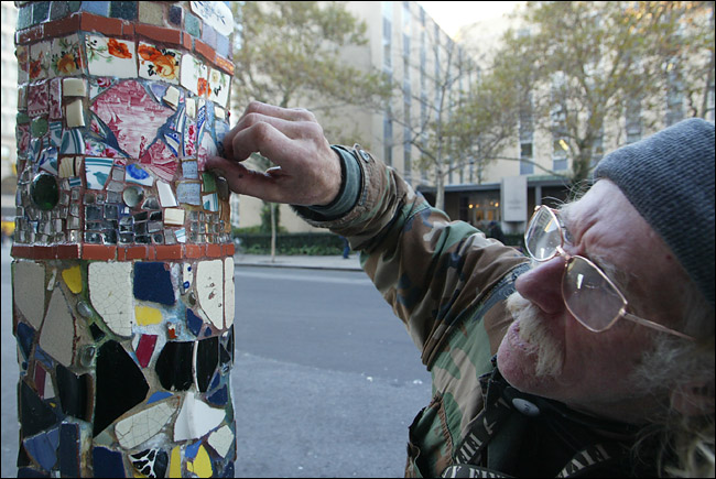 Jim Power works on one of his mosaics in the East Village.