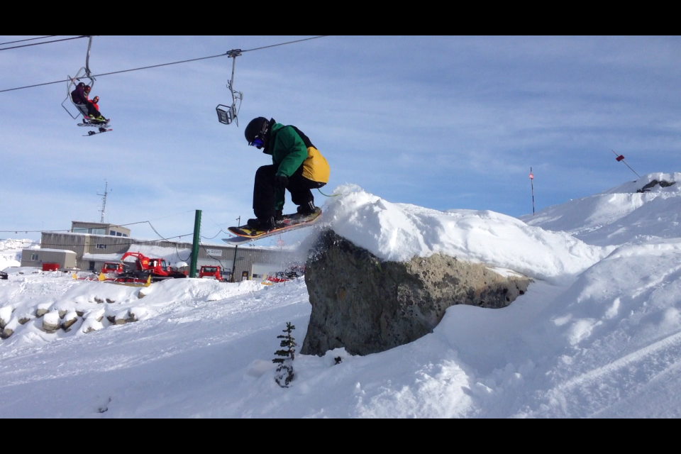 Jesse Davidson showing off under the Big Red Chair @ Whistler