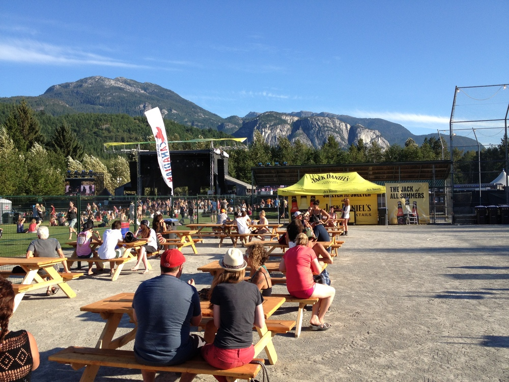 Thursday evening Stawamus Stage with the Stawamus Chief in the background at Squamish Valley Music Festival, gates just opened and we are already at the beer garden.