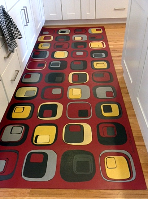 Custom rug for galley kitchen designed to coordinate with upholstery fabric.