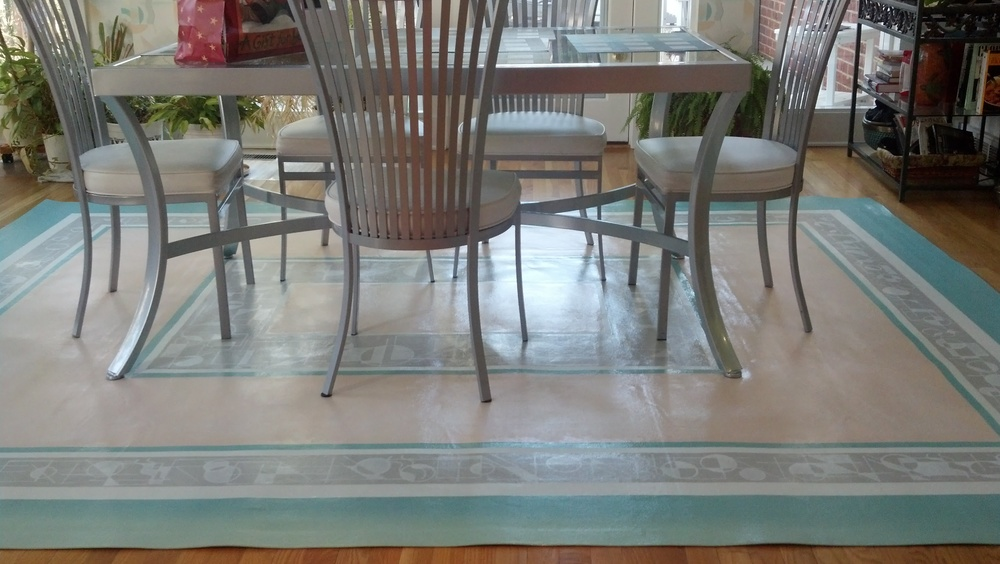 Dining rooms are particularly well suited for a painted floorcloth.