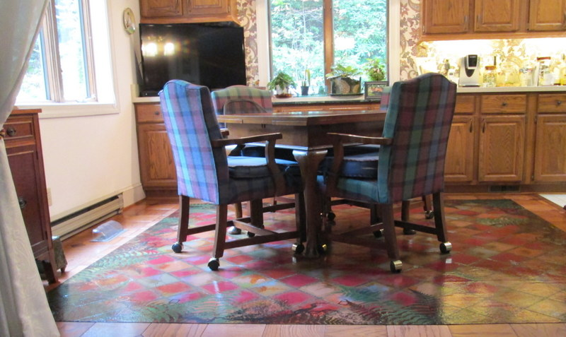 8.5' x 9' Painted Canvas Rug for a casual dining area. Cut canvas edge.
