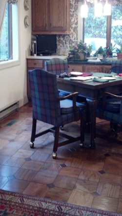 The casual dining room area was designated for a painted floorcloth in order to protect the floor from the rolling chairs, and provide easy cleaning for everyday use.