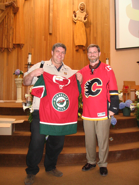 Jeff is presented with a Calgary Flames Jersey