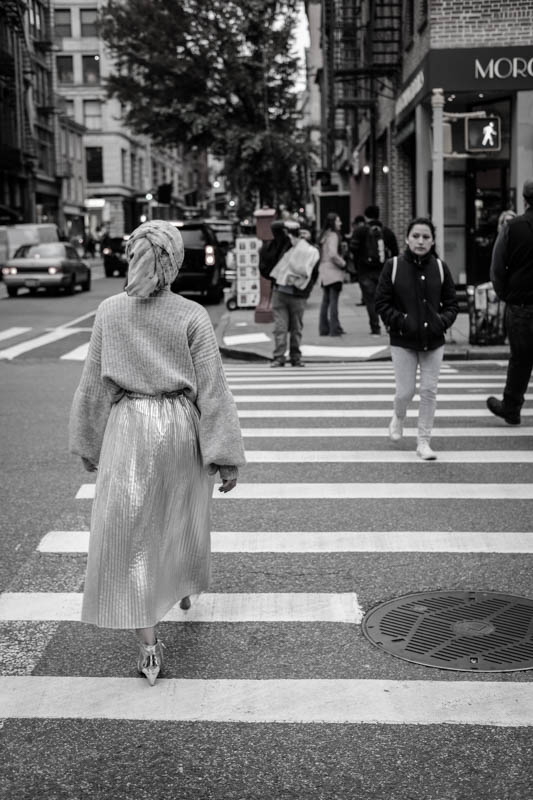New York is very exciting. Great for street photography. This girl, in costume, was doing some kind of photo shoot. She was dressed all in silver, just walking back and forth while the man across the street kept shooting...
