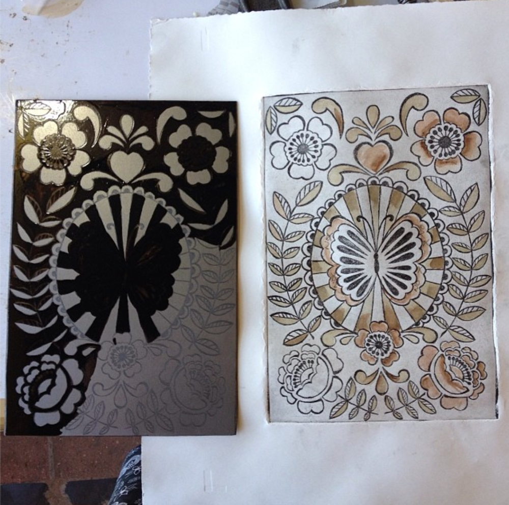 On the left is the metal that is being aquatinted. Aquatinting adds nice shading and dimension to the piece. To the right is my first proof with watercolor added to the parts I will aquatint.