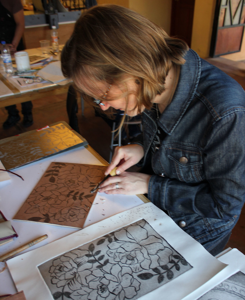 Working on a woodcut.
