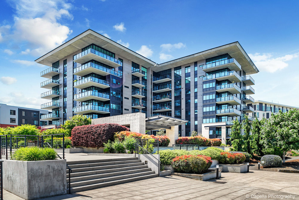 Pacifica Tower's open courtyard provides seamless access to the Willamette River.