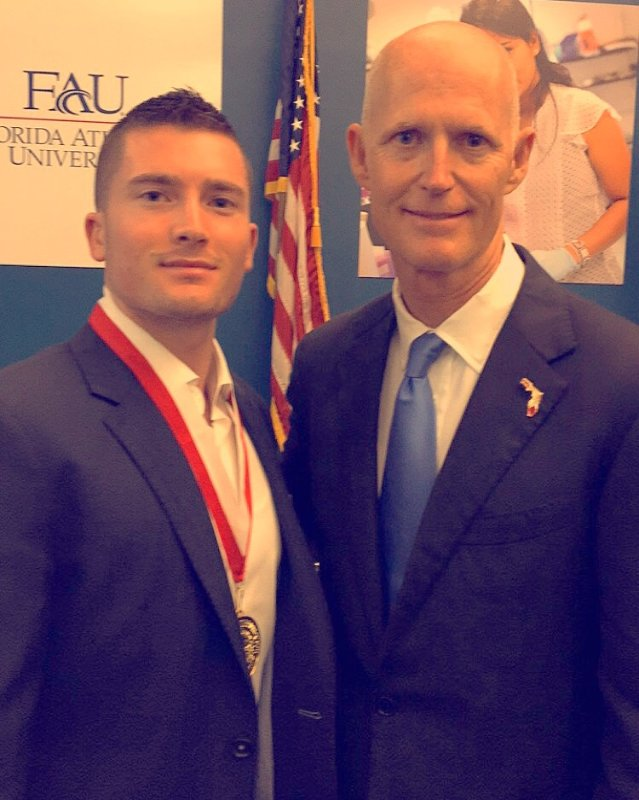 Jared Shlager (on left) and Governor Rick Scott (on right)