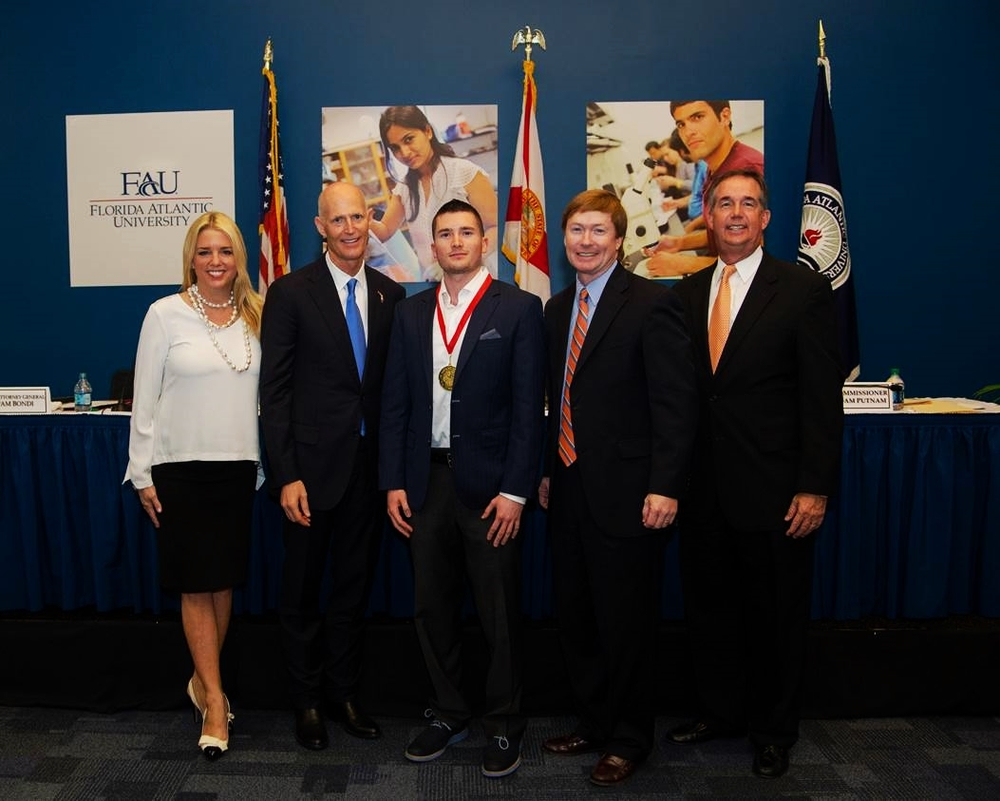 Governor Rick Scott, Jared Shlager, and the Cabinet.