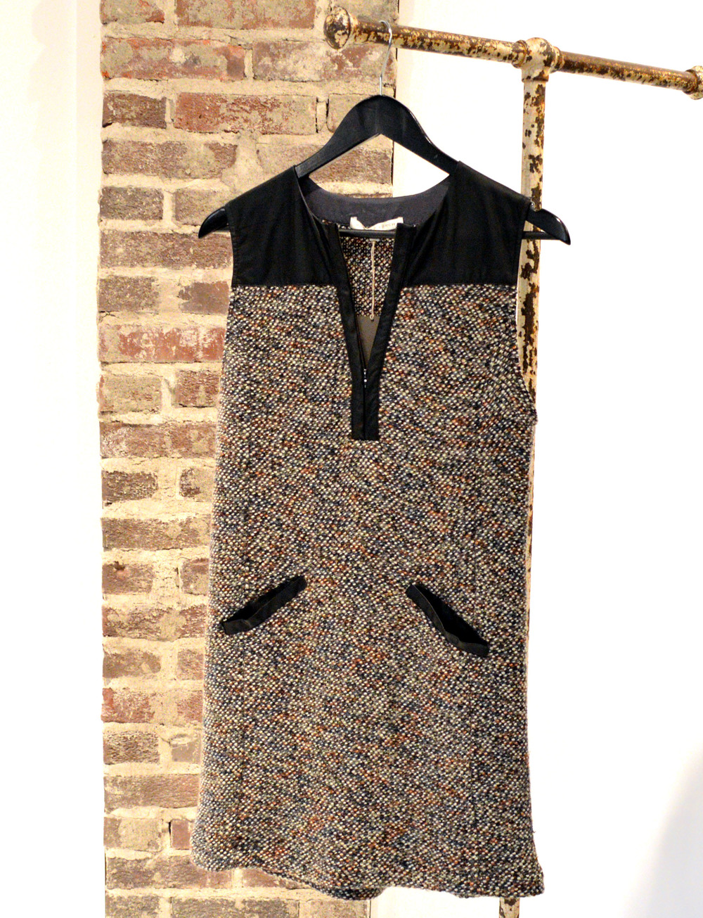 This leather and tweed dress looks great with black leather booties and a button-up or sheer black tee underneath! $395