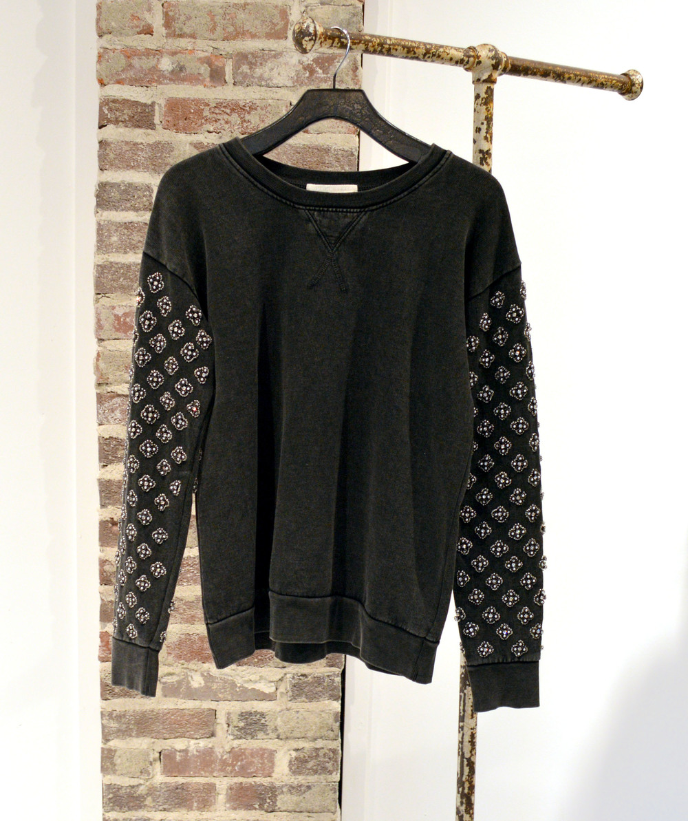 Pair this embellished pullover with leather leggings or coated denim - $340