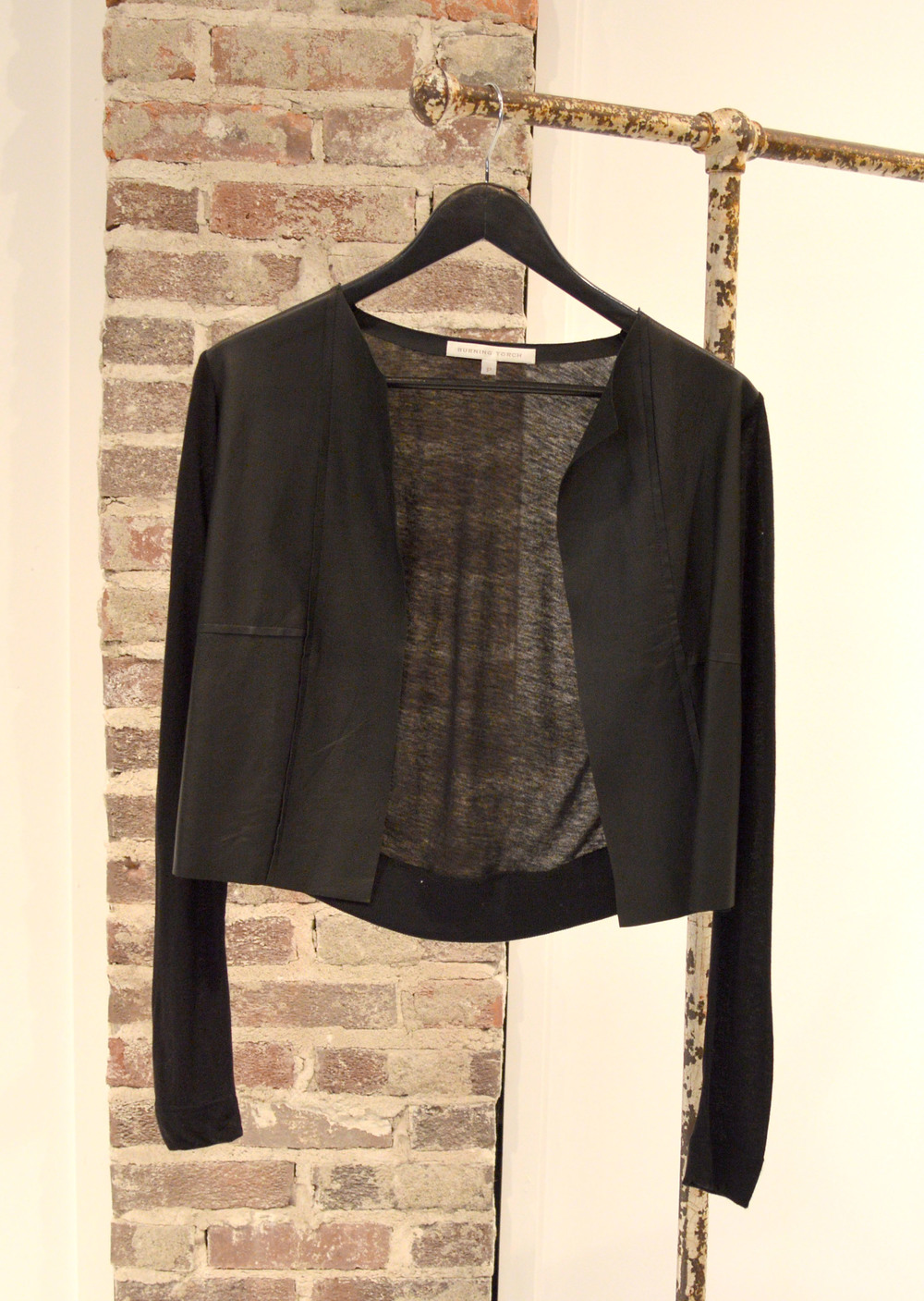 Throw this leather front jacket/cardigan over anything to add a classy, yet edgy look to your ensemble! $355