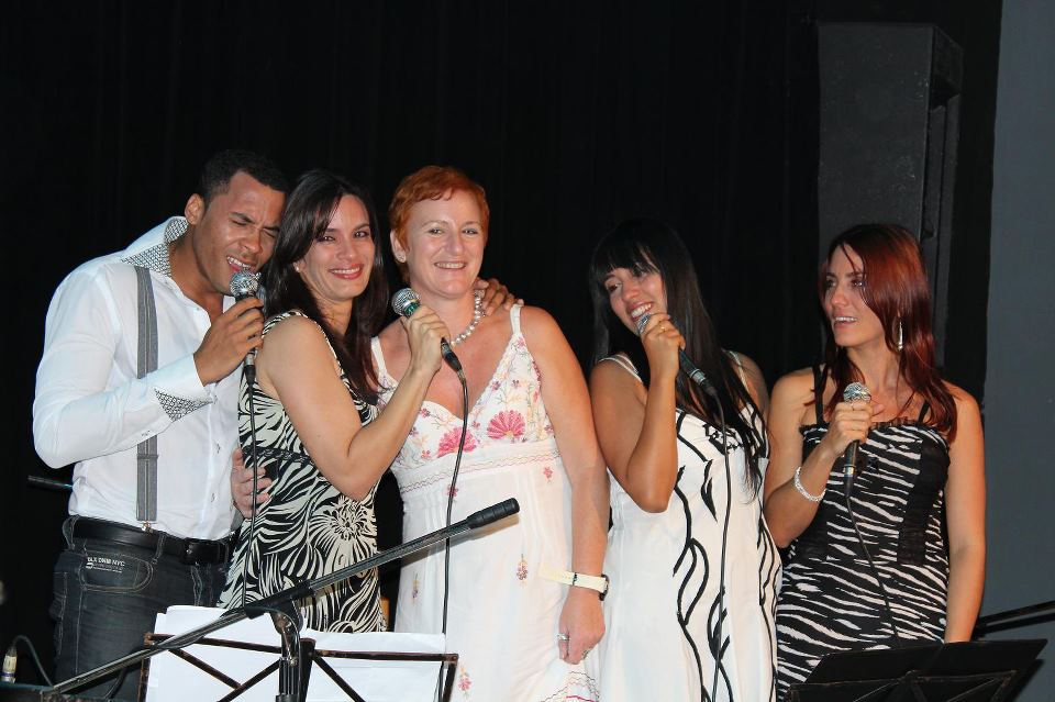 Hakely Nakao (second from right), singer and founder of the vocal group  Zambá .