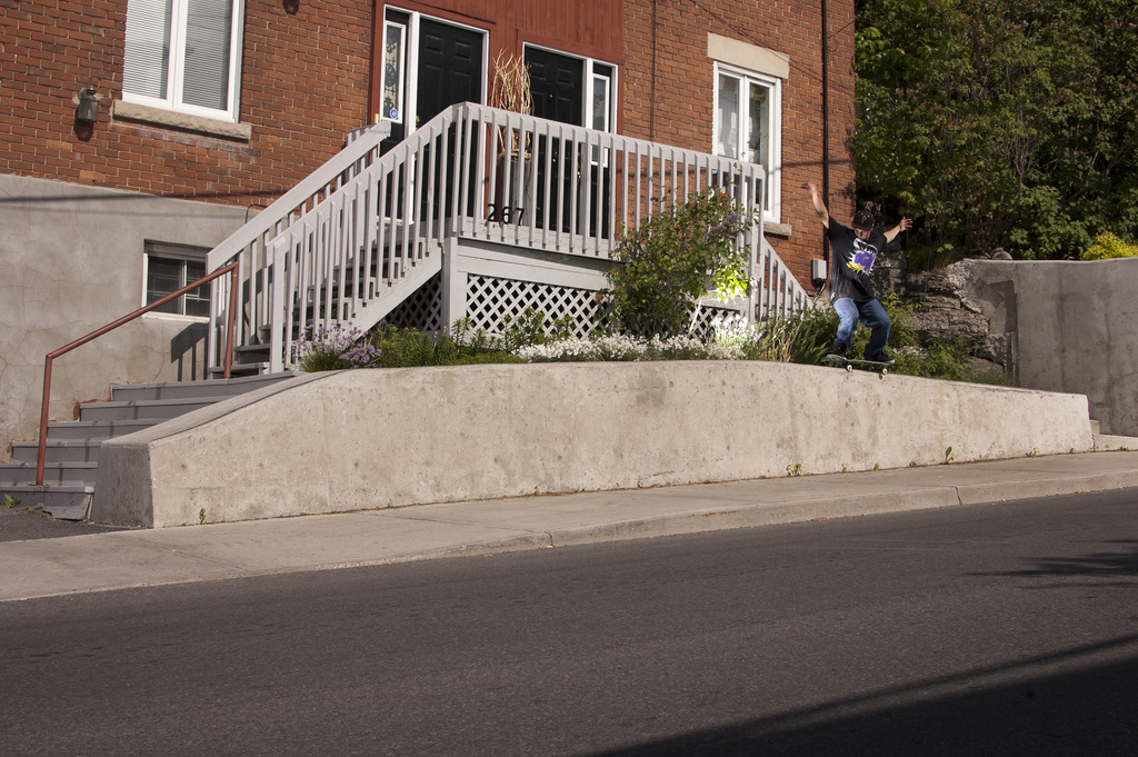 This is an old photo of Mitch Barrette 50-50'ing across this ledge.