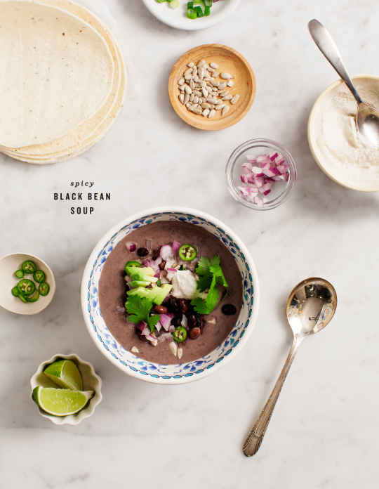 Photo Credit: Love & Lemons Spicy Black Bean Soup: click here for the full recipe from the lovely Love & Lemons blog Serves: serves 4 Ingredients splash of olive or grapeseed oil 2 small shallots, chopped 3 cloves of garlic, roughly chopped ½-1 jalapeño, de-seeded and chopped 4 teaspoons chile powder 3 cups black beans, cooked, drained (reserve a few for garnish) 4 cups low sodium vegetable stock up to ½ cup water, if necessary for blending consistency salt, pepper squeeze of lime optional: a few pinches of cayenne and/or smoked paprika serve with (all optional): diced red onion, jalapeño slices, avocado, cilantro, tortillas, sun cheese, salsa, or dried chile salsa