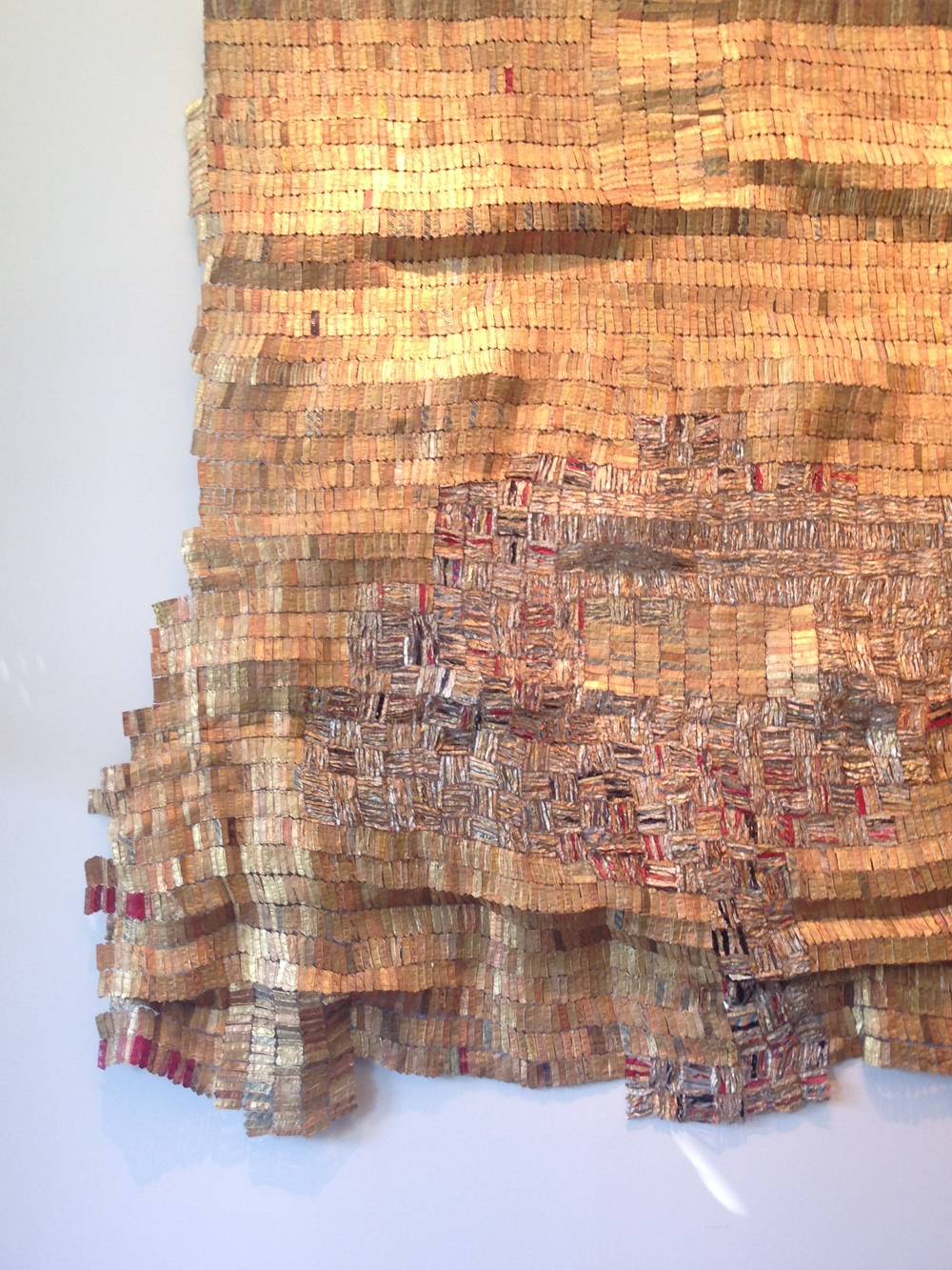 "Hover II, 2004 by El Anatsui of Ghana ~ Uses aluminum and copper wire to create this beautiful ""tapestry"" from old liquor bottle tops that were hammered out. Stunning example of reusing material in a beautiful way."
