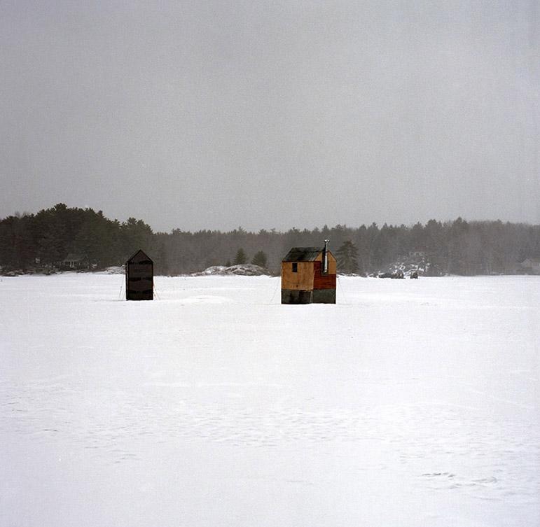 11. Dark houses on the frozen water