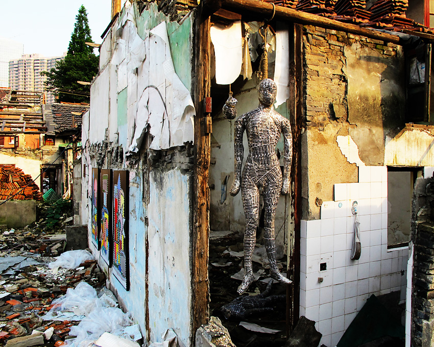 M120-reused, installation view, self doll in rubble field, Shanghai China, July 2010