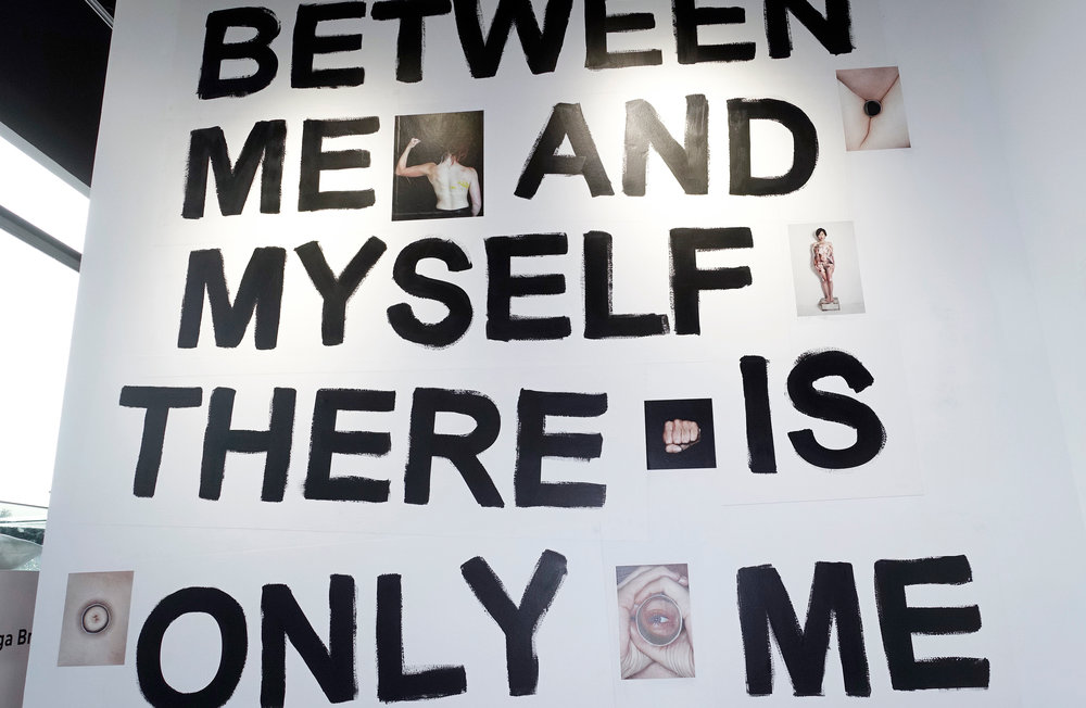 "Installation view (detail): ""between me and myself there is only me"", acrylic color, images from the book 21st century woman, printed on wall paper. 300 x 300 cm, side specific installation."