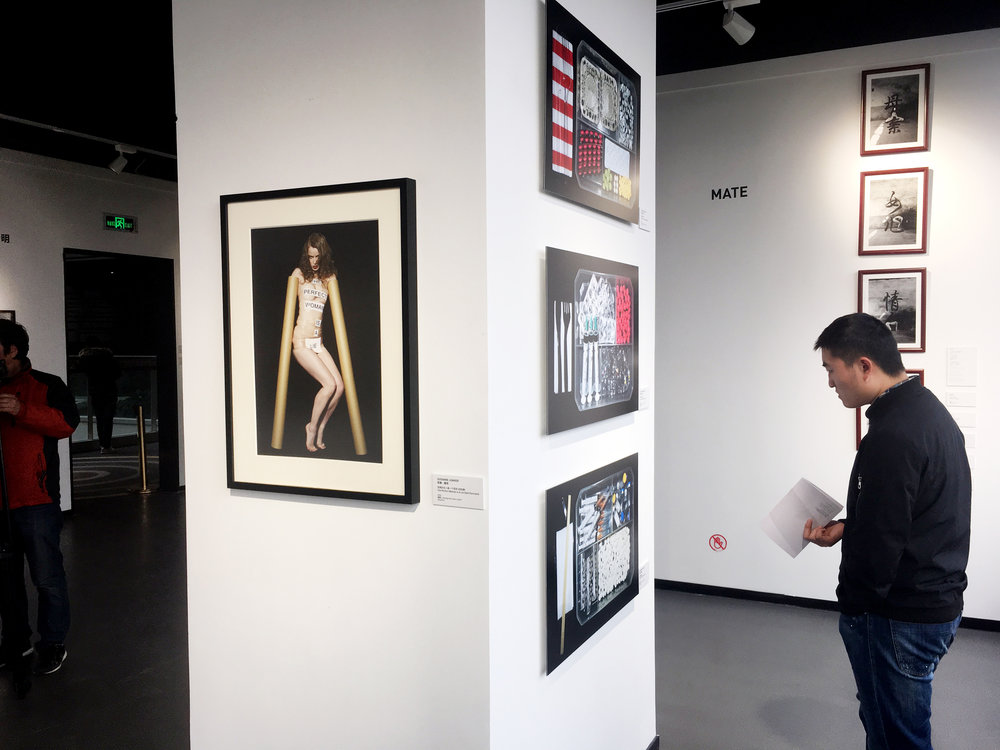 "Installation view. Left side: ""the perfect woman is a lie, 2006, 40 x 60 cm, lambda print, framed. Right side: the fertility meal, series of 3 photographs, Epson paper (exhibition piece),  2015,  80 x 50 cm."