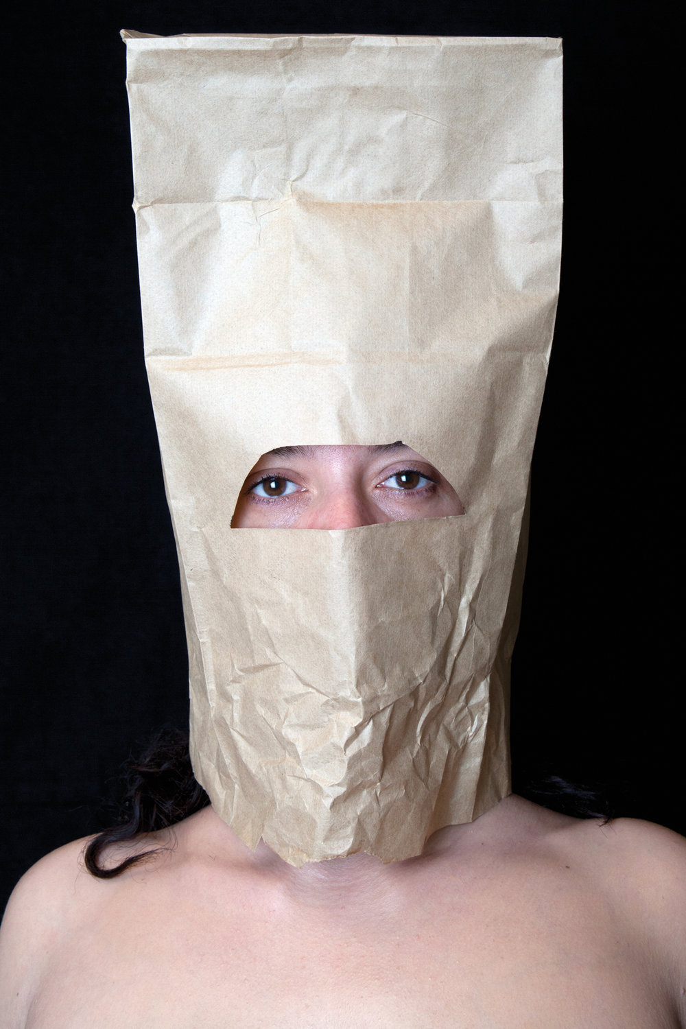 portrait with paper bag  , 2016, from the series: 21st century woman, photograph, sizes vary.