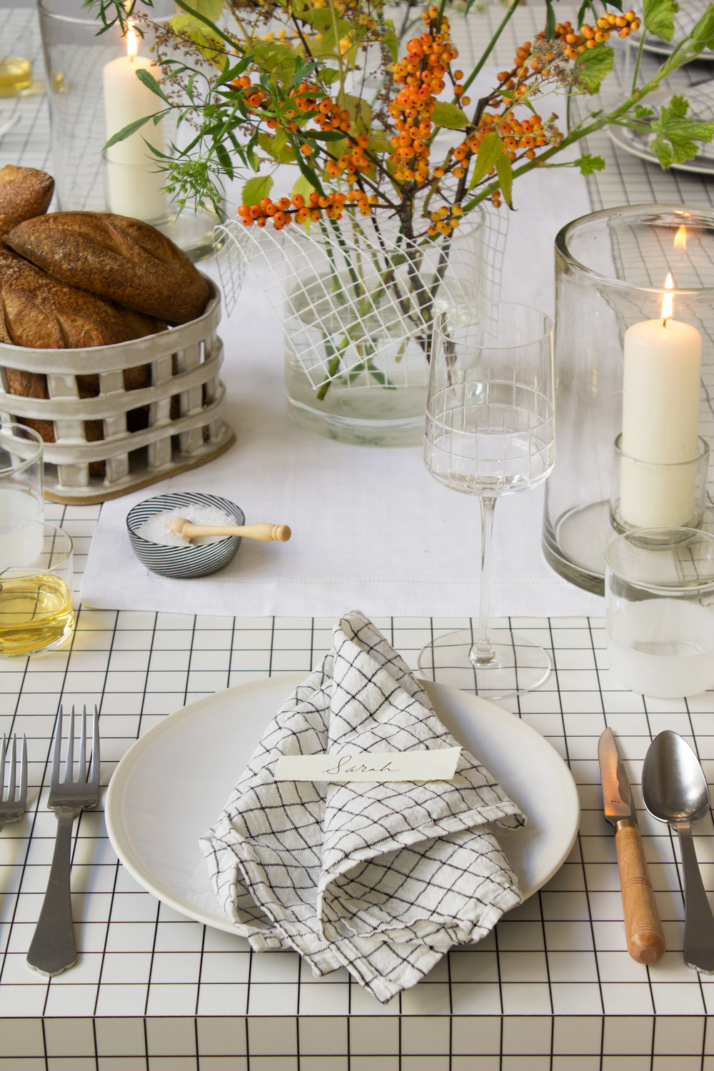modern-thanksgiving-table-setting-grids-orange-flowers-black-white-david-stark.jpg