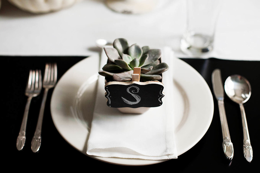 A small succulent with chalkboard label makes a fun take home gift, but is great for you if the guests can't take them home!