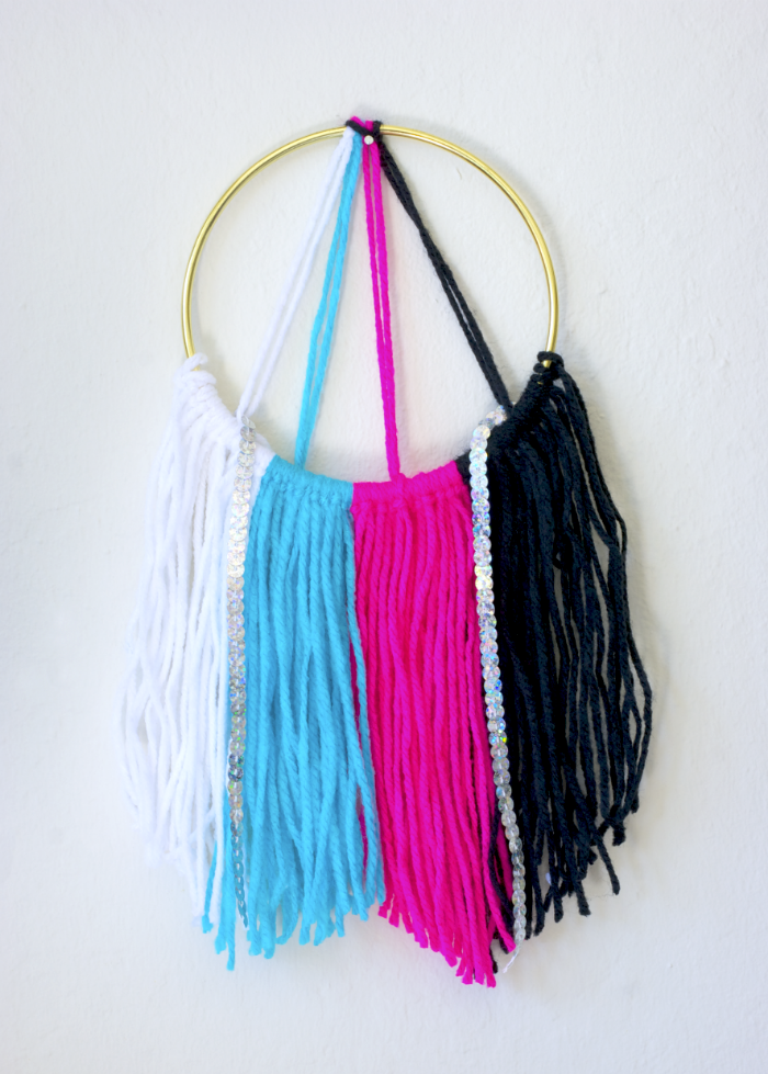 DIY Glam Yarn Wall Hanging via A Charming Project
