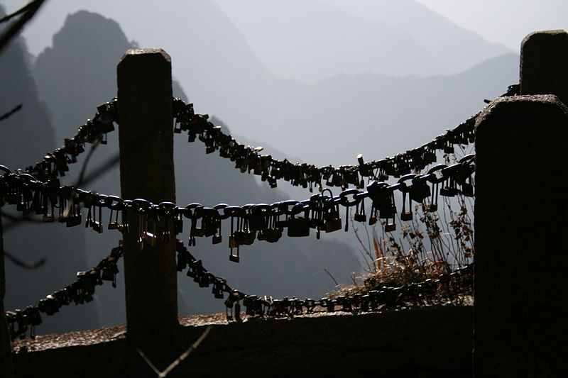 Nearly every metal chain-link fence or metal pole in  Mount Huang ,  China  has been adorned with padlocks, where it is customary to 'lock your soul' together and then throw the key over the edge of the cliff into the misty valleys below. This may be where the tradition originated.