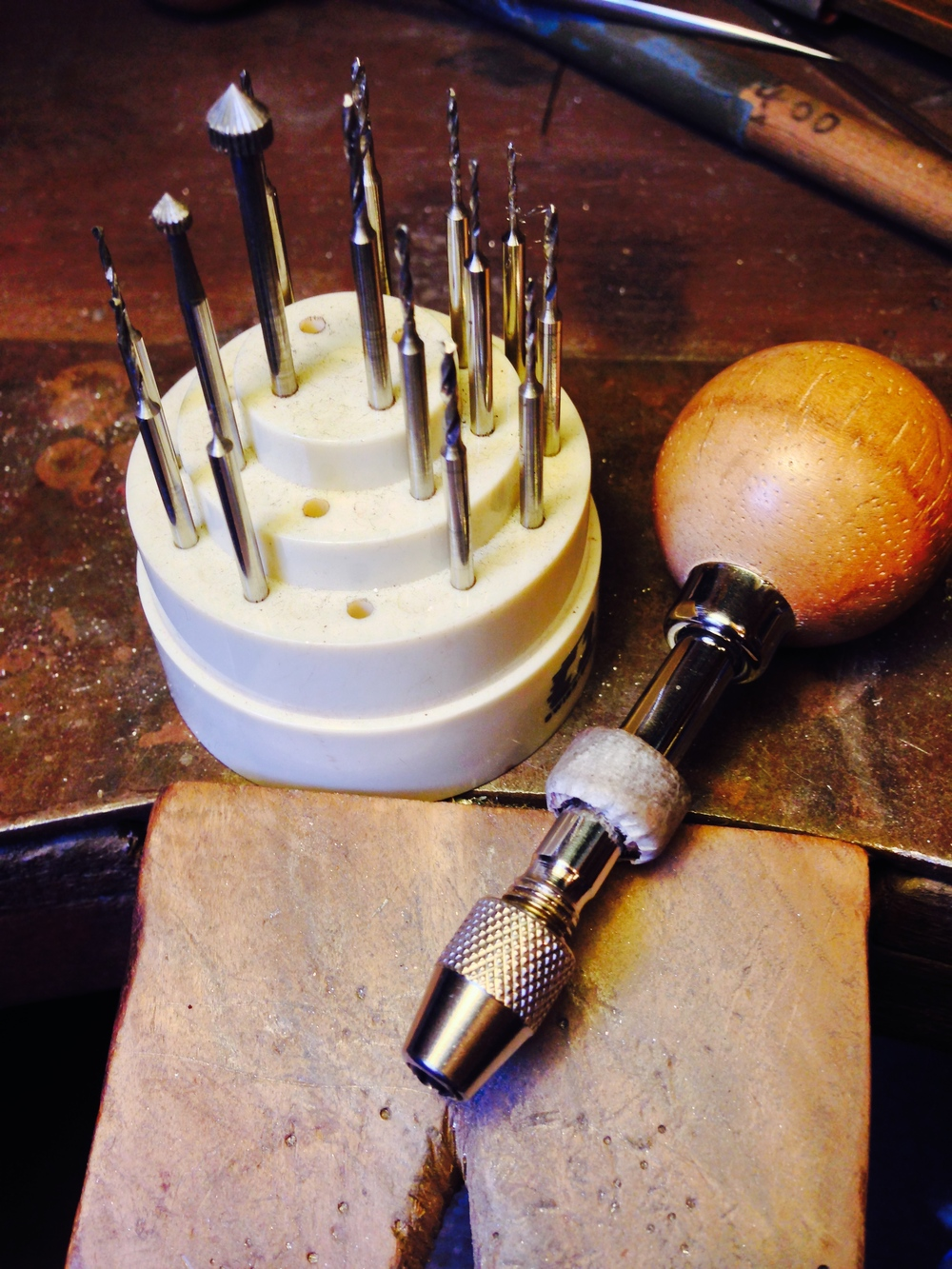 My hand drill and a selection of drills and burrs used for setting stones.