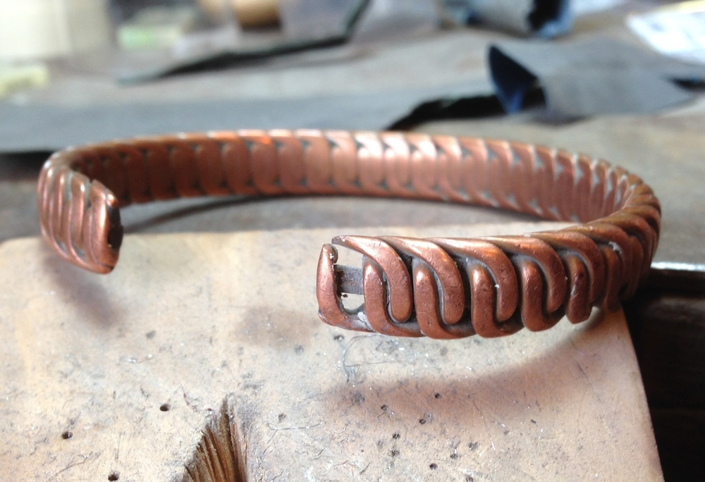 The copper bangle showing how part of the end had snapped off.