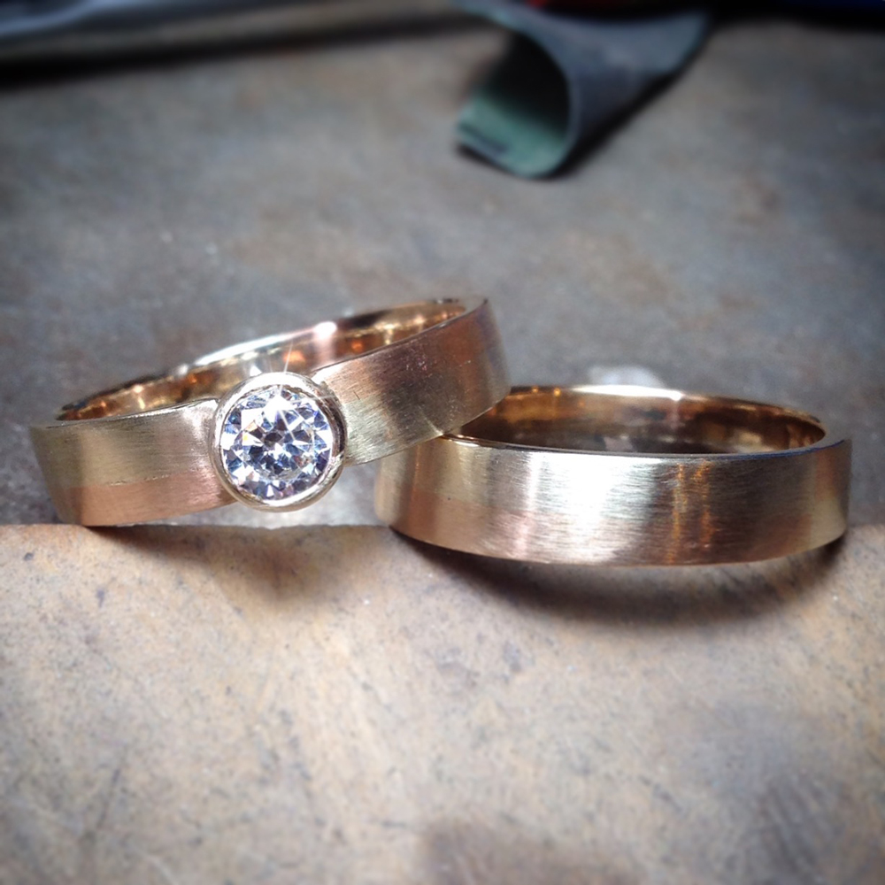 I loved making these! They were created by remodelling the client's own 22ct and 9ct gold jewellery that was very sentimental to him as it belonged to his grandmother. He also chose to add a beautiful 1/2ct lab grown diamond to his fiancee's engagement ring.