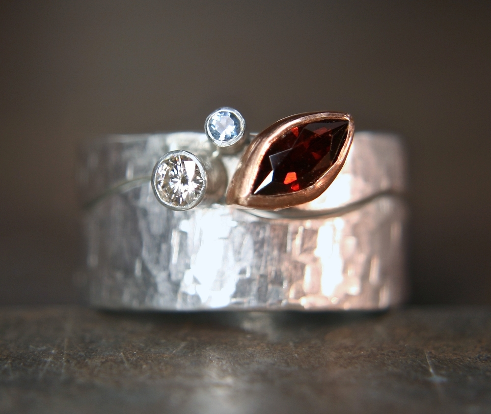 Malvern Hills inspired ring set. Made from recycled silver, 9ct rose gold, fair trade garnet, aquamarine and moissanite.